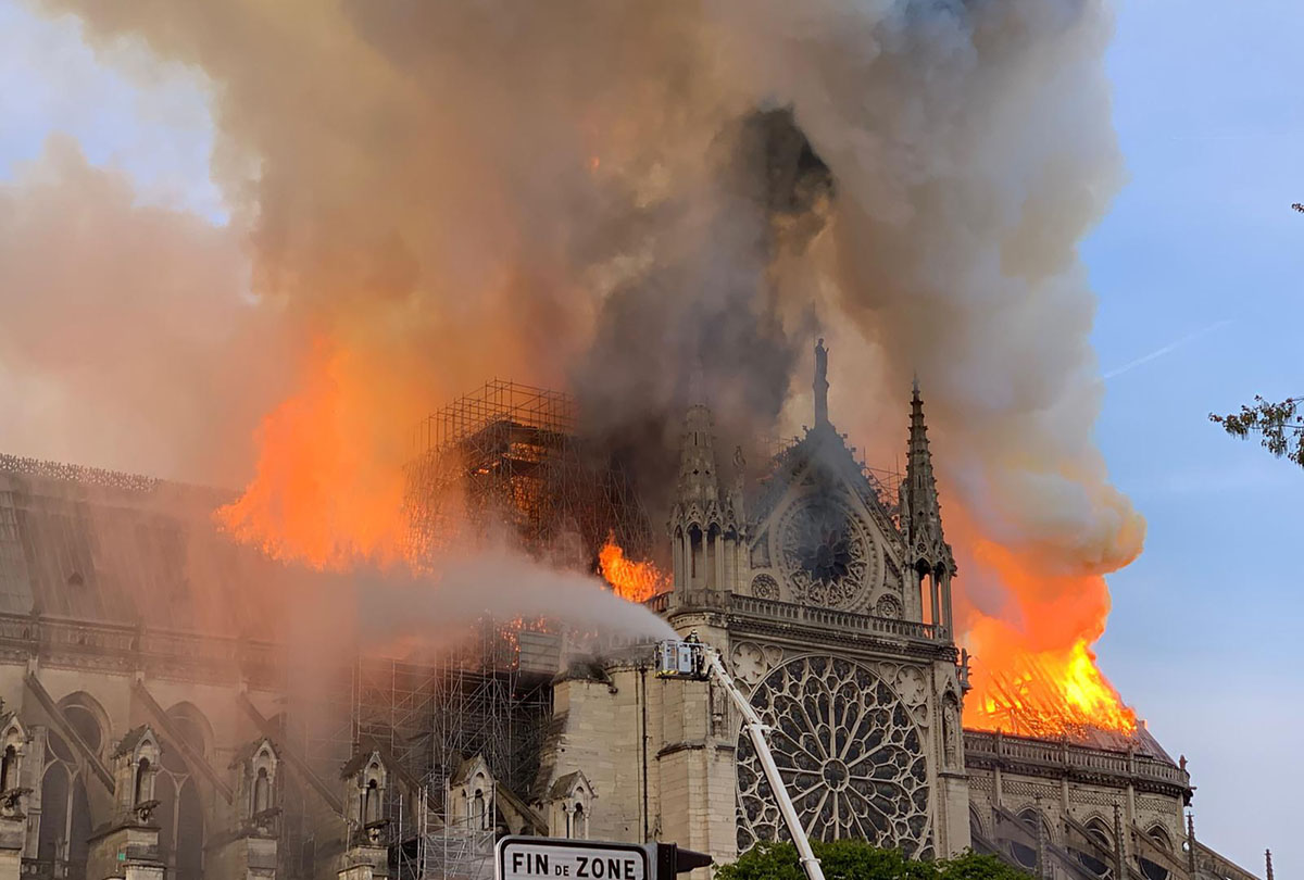 Flames and smoke are seen billowing from the roof at Notre Dame Cathedral on April 15 2019